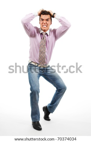 A man grasp his head with his hands and with grimace on his face when something terrible just has happened - stock photo