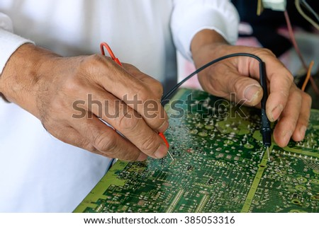 a man hand uses a voltage meter to check for dead circuits, faults and - stock photo