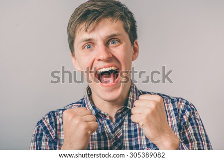 a man happy with his fists - stock photo