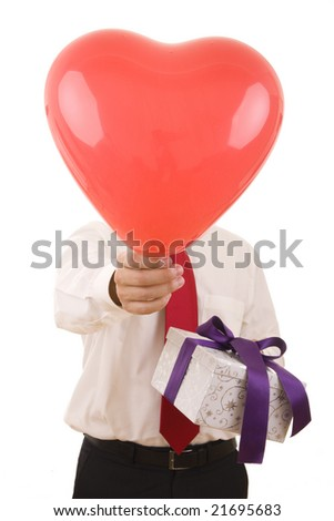 A man holding a big heart and a gift - stock photo