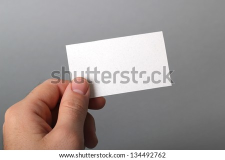 A man holding a business card - stock photo