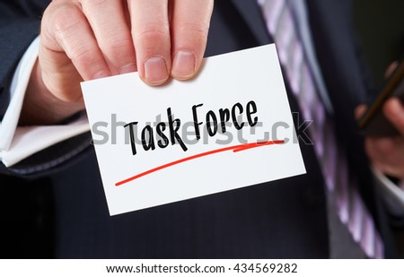 A man holding a Business card Task Force Concept