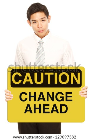 A man holding a conceptual business signboard on Change - stock photo