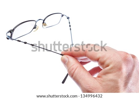 A man holding a fashion eyewear for vision. On a white background. - stock photo
