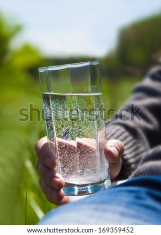 A man holding a glass of clean water - stock photo