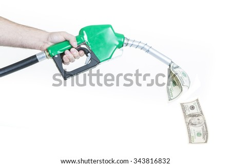 A man holding a green gasoline nozzle with money spilling out.