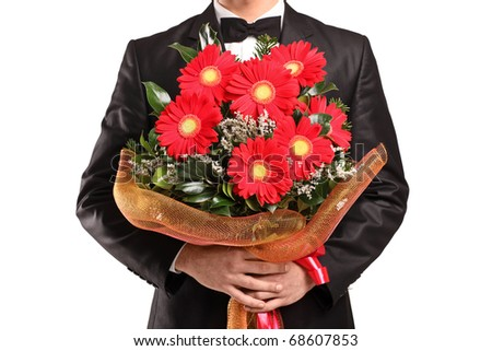 A man holding a large bouquet of flowers isolated on white background - stock photo