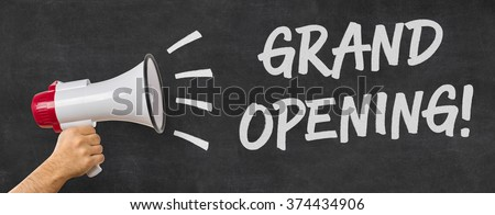A man holding a megaphone - Grand opening - stock photo