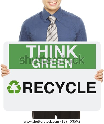 A man holding a signboard with an environmental message - stock photo