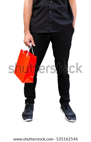A man holding colorful paper bag isolated on white background.