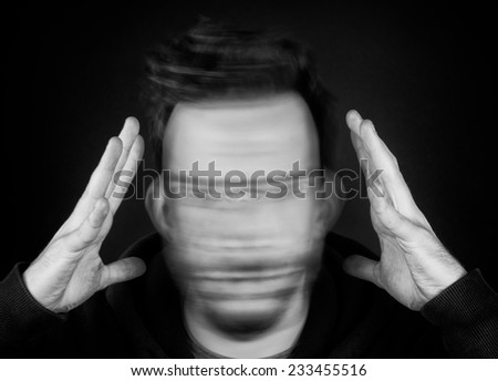 A Man Holding His Head and Shaking - stock photo