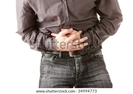 A man holding his stomach because he has diarrhea - stock photo