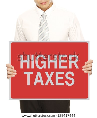 A man holding sign indicating Higher Taxes - stock photo