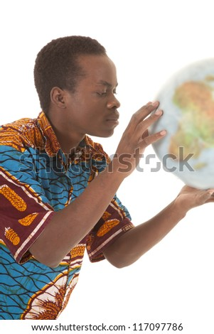 A man holding the world globe in his hands looking up close. - stock photo