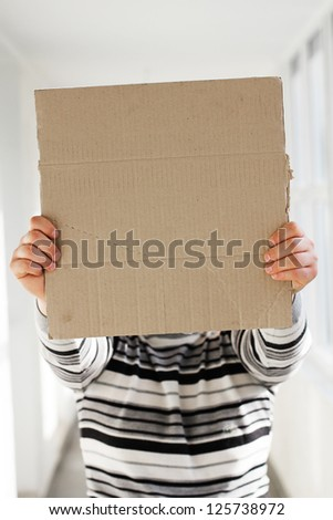 A man holds a banner, poster - stock photo