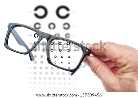 A man holds Glasses. On a white background. - stock photo