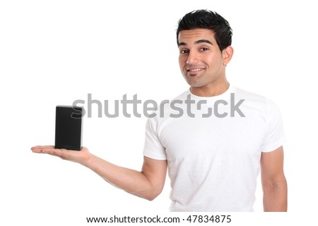 A man holds your merchandise retail product in the palm of his hand.   He is dressed in a white t-shirt and is smiling.  Add your design or place your own object in his hand. - stock photo