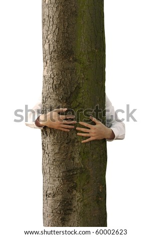 A man hugging a tree - stock photo