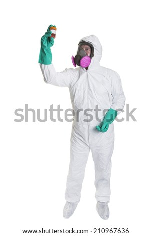 A man in a bio hazard suit looking at a sample, shot on a white background. - stock photo