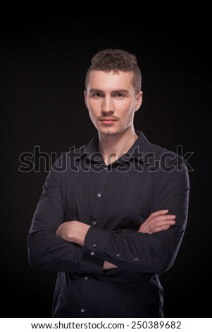 a man in a black shirt on a black background