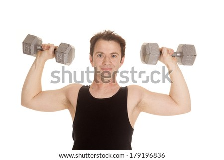 A man in a black tank top working out flexing some weights. - stock photo