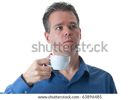 A man in a blue dress shirt, holding a small cappuccino / coffee cup, isolated on white.