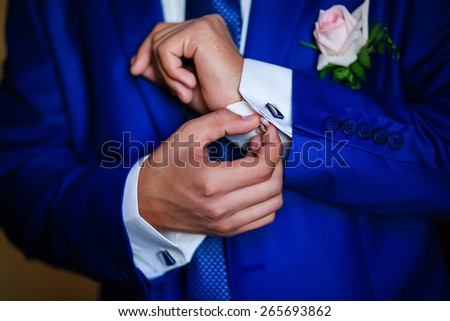 a man in a blue suit stud buttons - stock photo