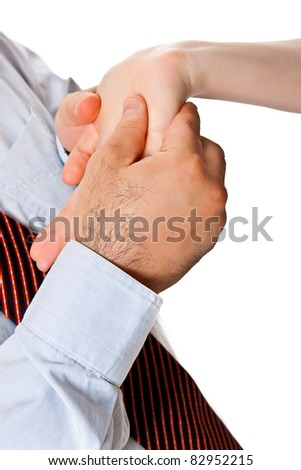 A man in a bright shirt and tie examines women's hands. Palmistry close-up isolated on a white background - stock photo