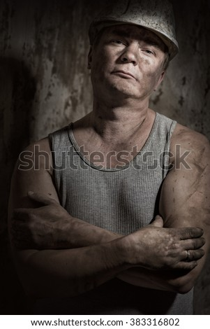 A man in a helmet miner - stock photo