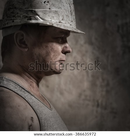 A man in a helmet miner
