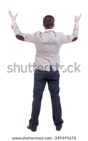 A man in a jacket raised his hands in prayer.   Standing young man. Rear view people collection.  backside view of person.  Isolated over white background. - stock photo