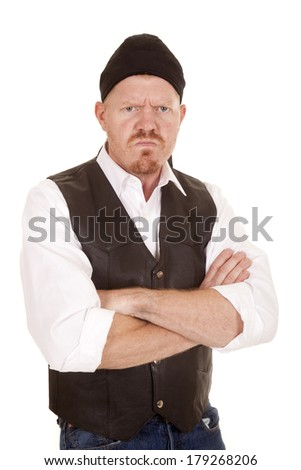 A man in a vest is very mad with his arms folded - stock photo