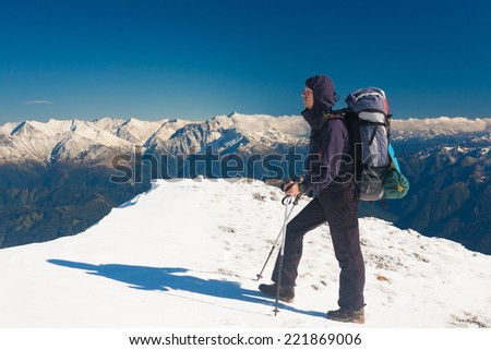 A man in beautiful  mountain  day winter landscape  snow background - stock photo