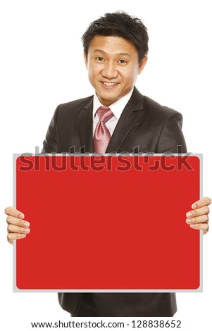 A man in business attire holding a red blank message - stock photo