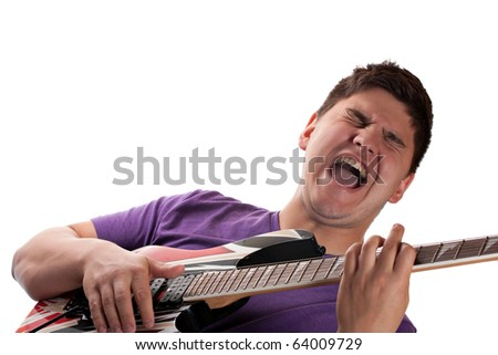 A man in his late teens playing his electric guitar over a white background. - stock photo