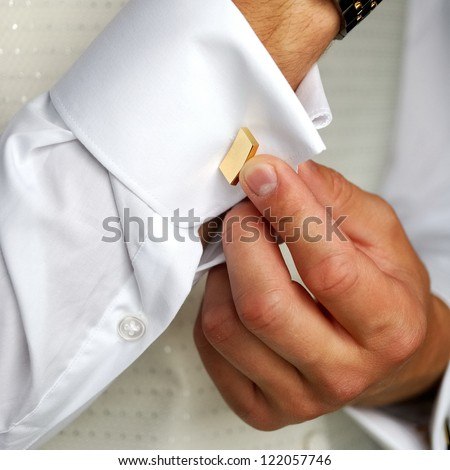 a man in wedding suit preparing his look - stock photo