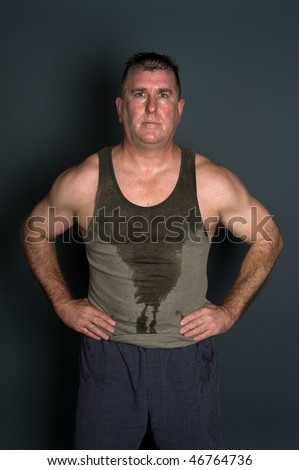A man is all sweaty after a hard workout.