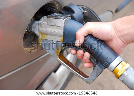 A man is fueling his car