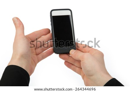 A man is holding a cellular phone in his hands, isolated on a white background. - stock photo