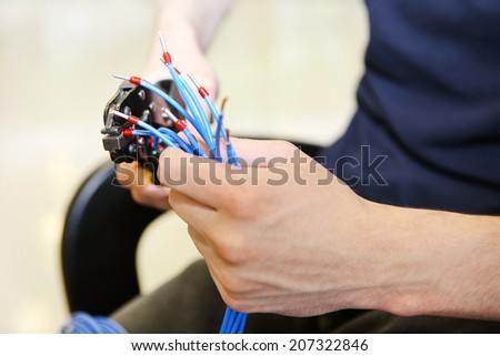 A man is preparing electrical cables - stock photo