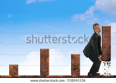 A man is ripping up the last bar in a graph and forcing it up which illustrates many business and marketing concepts; Marketing, Successful Stock Advice, White Collar Crime, Accounting. - stock photo