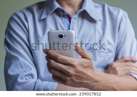 A man is using his smart phone - stock photo