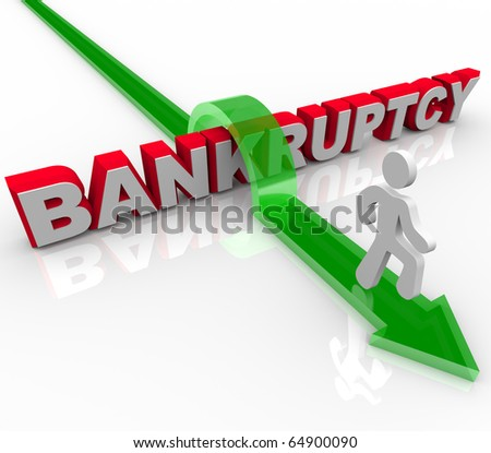 A man jumps over the word bankruptcy, symbolizing freedom from debt - stock photo