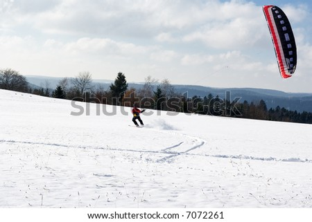 A man Kiting with his snowboard - stock photo