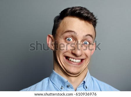 stock photo a man laughing hysterically at something hilarious with a funny expression on his face 610936976 laughing hysterically stock images, royalty free images & vectors