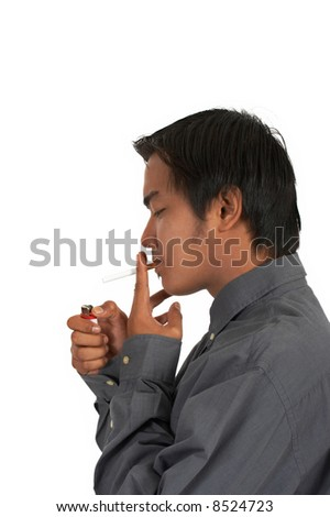 a man lighting a cigarette over a white background - stock photo