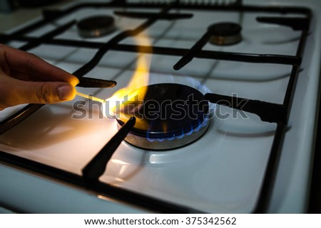 A man lighting the gas stove with a match & Man Lighting Gas Stove Match Stock Photo 375342562 - Shutterstock azcodes.com