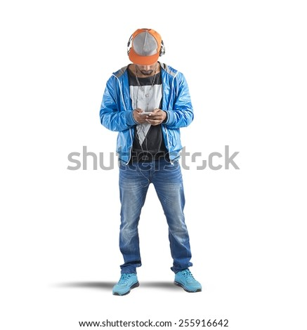 A man listening hiphop music with headphones - stock photo