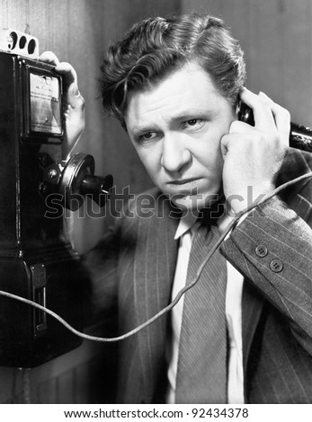 A man listening on the telephone