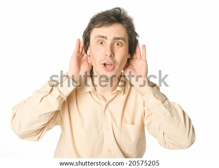 A man listening to something with a surprise - stock photo